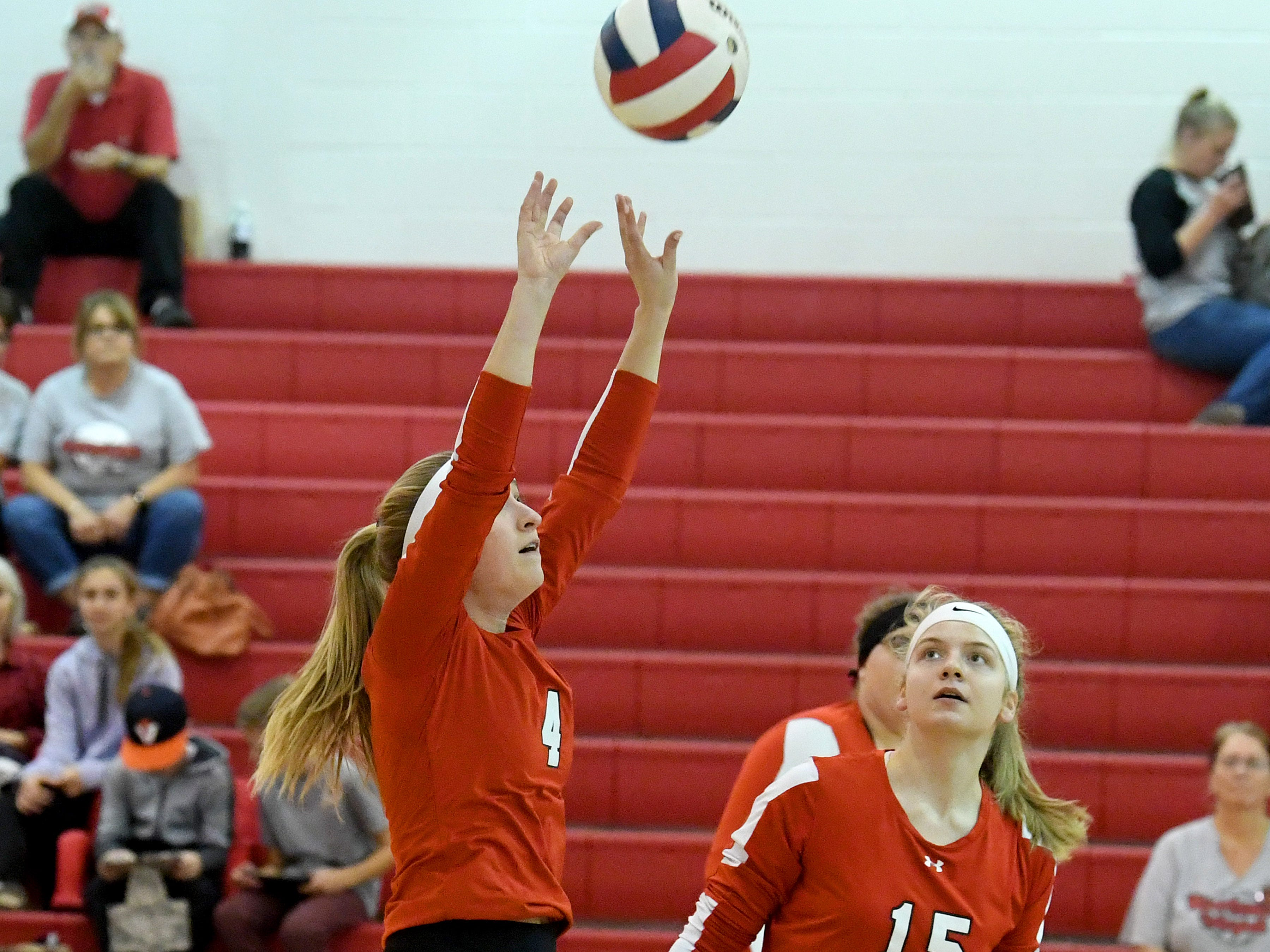 Riverheads' Emma Tomlinson sets the ball as teammate Eva Frederick watches during a Region 1B quarterfinal match, played in Greenville on Thursday, Nov. 1, 2018.