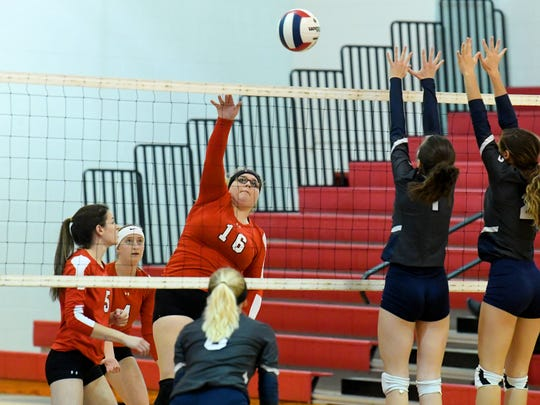 Riverheads' Olivia Modlin hits the ball back across the net past William Campbell's Crystal Hedrick and Brentley Bomar during a Region 1B quarterfinal match, played in Greenville on Thursday, Nov. 1, 2018.