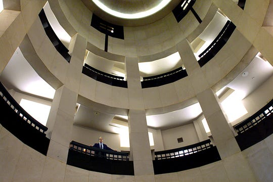 Jack Poitinger, looks over the railing of the rotunda at the Leon County Courthouse in this 2006 photo. Poitinger died Wednesday at age 77.