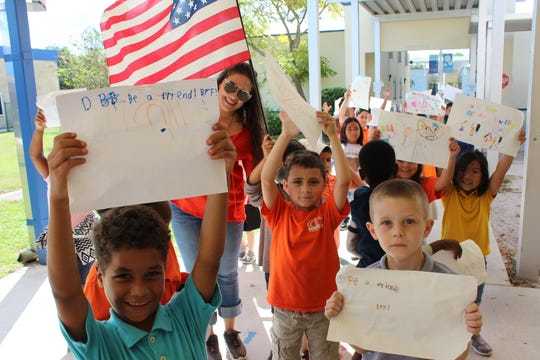 Northport Drama teacher Allison Barajas walks with her students for Northport 8th annual Unity Day.