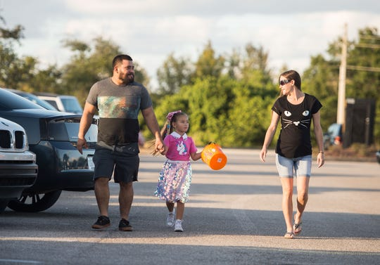 """Children and adults trick or treat for Halloween at the Indian River Mall's """"Mall-O-Ween"""" event Wednesday, Oct. 31, 2018, in Vero Beach."""