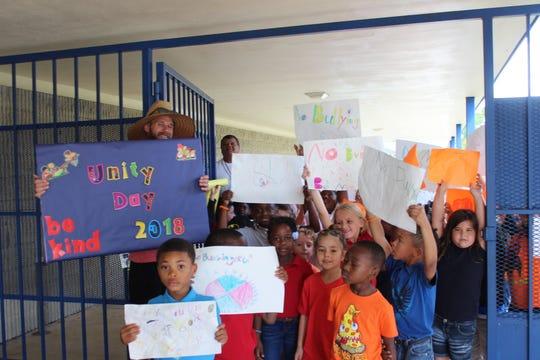 Northport coach Daryn Ploeckelman promotes Unity Day bullying awareness at school.