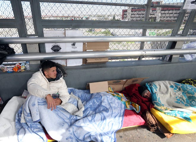 A migrant from Cuba rests and waits on the Mexican side of the Paso Del Norte international bridge Thursday.