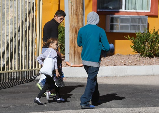Recently released migrants move freely around the grounds of an El Paso motel as they await transportation to be united with relatives.
