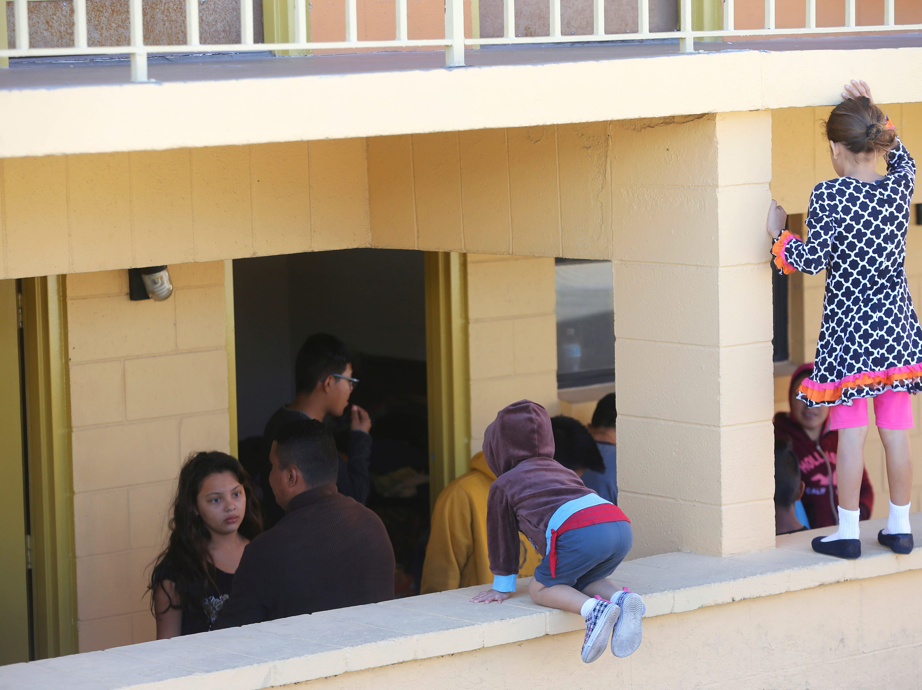 Recently released migrants move freely around the grounds of a local El Paso motel as they await transportation to be united with relatives.