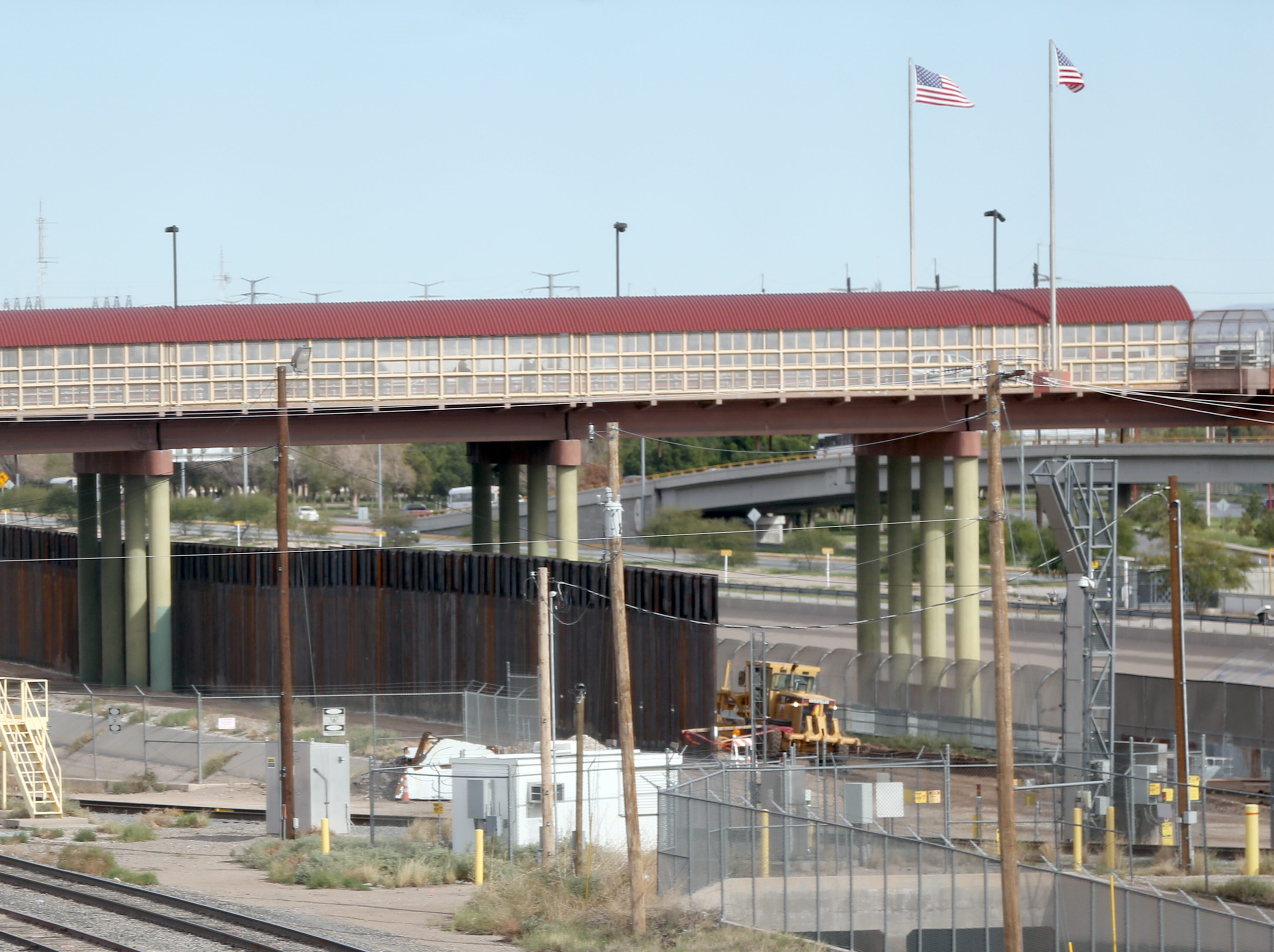Construction of the border fence is visible from the Paso Del Norte international bridge Thursday. The new barrier is currently being installed under the Stanton Street international bridge.