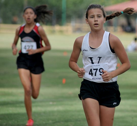 Madeleine Locher of Ventura High wins the girls race at the Pacific View League cross country championships at College Park in Oxnard on Thursday. The Ventura girls won the team title.