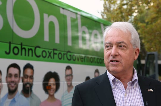 Republican gubernatorial candidate John Cox talks to reporters before beginning a statewide bus tour Thursday in Sacramento. Cox is running against Lt. Gov., Democrat Gavin Newsom in the Nov. 6 election.