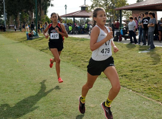 Ventura's Madeleine Locher leads Rio Mesa's Elisse Weinerth of Rio Mesa at the Pacific View League cross country championships Thursday at College Park in Oxnard.