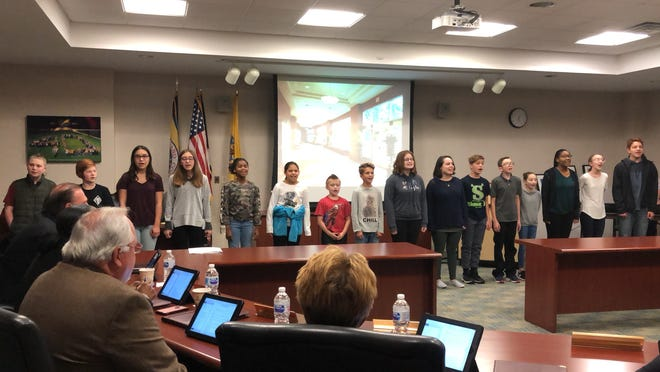 """Members of the Cumberland County College Board of Trustees enjoy a preview of the college's Department of Theatre's production of """"Oliver!"""" presented by some of the show's youngest actors during a recent meeting. The show opens Nov. 15."""