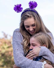 Central Valley Christian sixth grader Lizzy Highstreet, 11, hugs her sister Olivia Highstreet, 15, during her return to school Wednesday, October 31, 2018. Highstreet is recovery from a double lung transplant at Stanford Hospital brought on by Cystic Fibrosis. She is their first pediatric patient to go from life support directly to transplant. She and her father traveled in Visalia's new fire truck 55 on its first road trip.