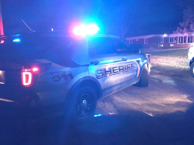 A Marathon County Sheriff's Department vehicle shuts down a road in Rothschild on Wednesday evening.