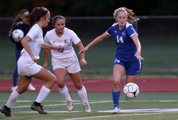 From left, Bronxville's Rachael Peacock (14) passes to a teammate against O'Neill during the Class B regional girls soccer semifinal at Arlington High School in Freedom Plains Oct. 31, 2018. Bronxville won the game 2-0.