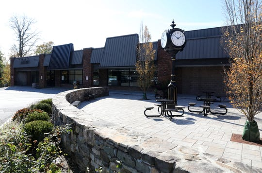 A large clock and outdoor seating area beside restaurants and the former DeCicco Family Market at Orchard Square Shopping Center in Cross River Oct. 31, 2018.