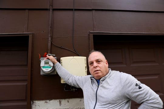New City resident Evan Katz beside his smart meter, which he says he was forced to get by Orange & Rockland Utilities even though he didn't want it.