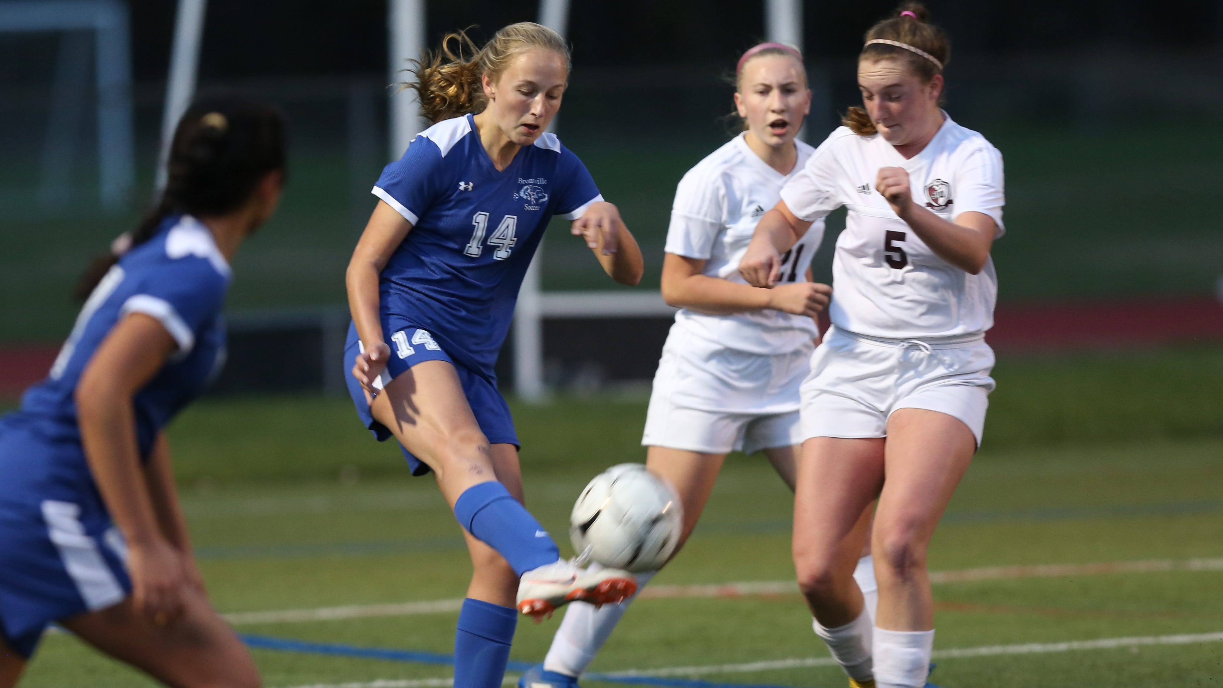 From left, Bronxville's Rachael Peacock (14) fires a shot against O'Neill during the Class B regional girls soccer semifinal at Arlington High School in Freedom Plains Oct. 31, 2018. Bronxville won the game 2-0.