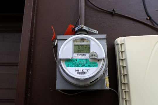 A smart meter, a new technology that measures the use of electricity, outside a home in New City on Nov. 1.