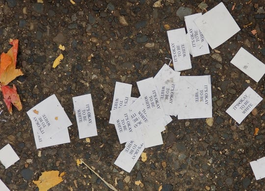 """Discarded """"It's okay to be white"""" cards after a Patriot Prayer protest in Portland, Oregon."""