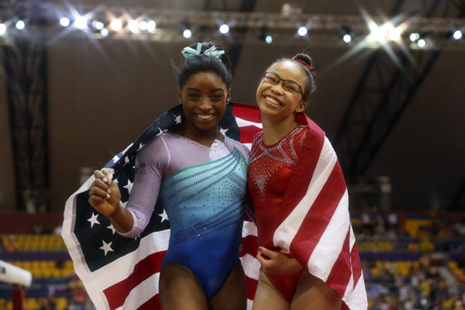 Simone Biles (left) and Morgan Hurd of the United States celebrate their gold and bronze wins, respectively, after the women's all-around finals of the 2018 FIG Artistic Gymnastics Championships at Aspire Dome on Nov. 1in Doha, Qatar.