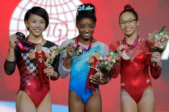 Gold medalist and four-time all-around world champion Simone Biles (center),  silver medalist Japan's Mai Murakami (left), and bronze medalist Morgan Hurd of the U.S. after the women's all-around final of the Gymnastics World Chamionships Nov. 1, 2018.