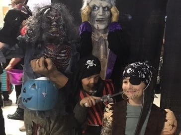 Landon Ryczek as a zombie, Clint Reed as a pirate and Brody Lemmer as a pirate at Cedar Creek Mall. They are all from Mosinee.