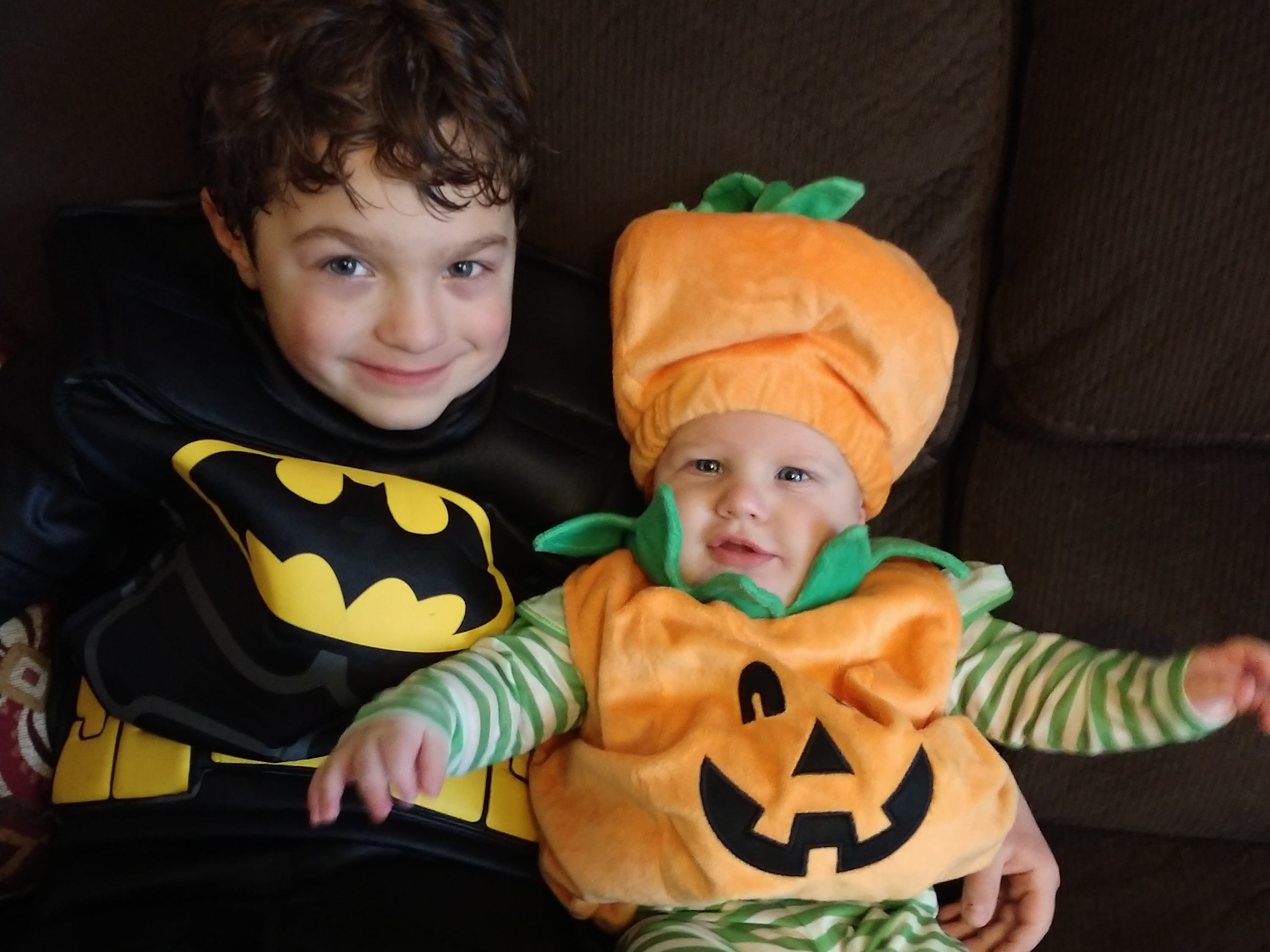 "Cordon, 7, as ""Batman,"" and Carter, 5 months, as a pumpkin. They are the children of Brock and Michelle Kuklinski of Mosinee."