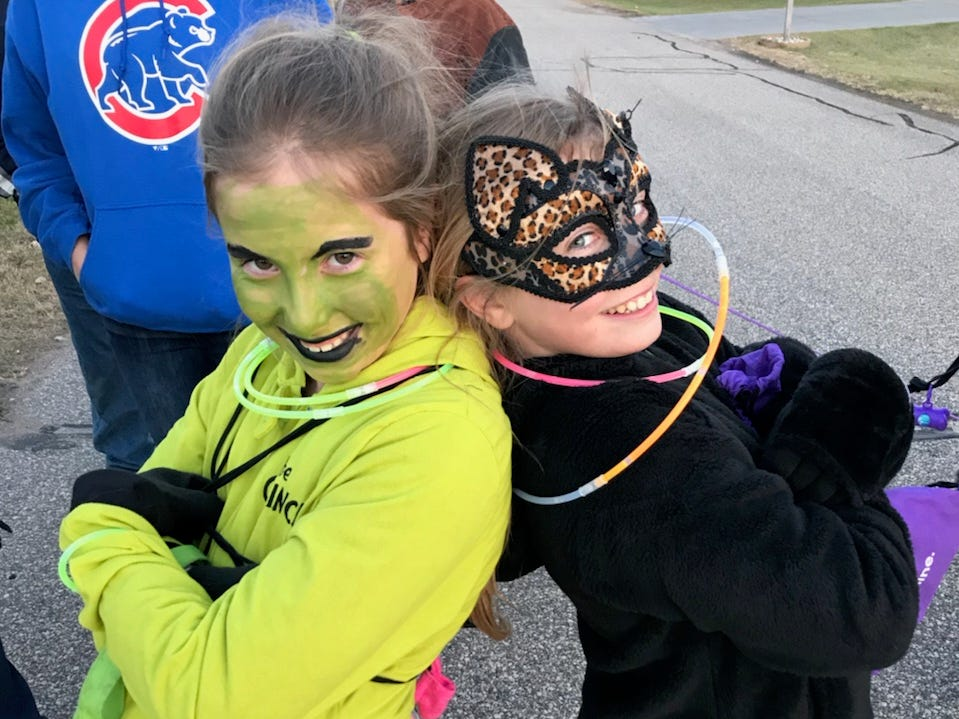 "Haley Peterson, 10, as ""The Grinch"" and her sister, Grace Peterson, 12, as a cat. They reside in Plover."