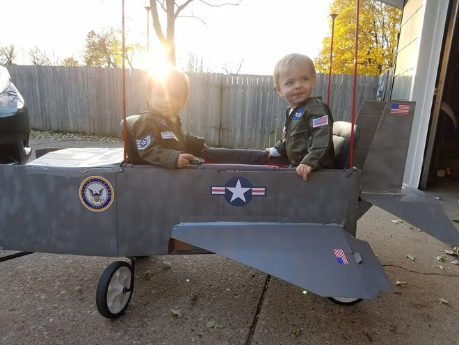"""Two-year-old twins Jacob and Mason Miller as """"Maverick"""" and """"Goose"""" from """"Top Gun."""" Their parents are Melissa and Andrew Miller of Wisconsin Rapids. Their jet was made using their wagon."""