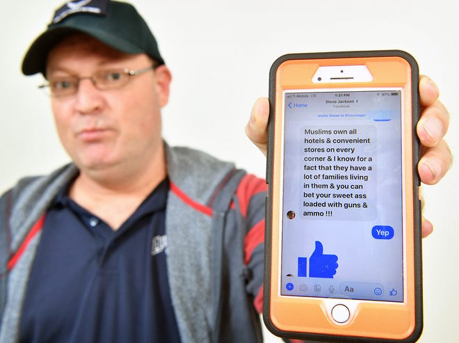 Paul Arbogast shows one of many comments from District 5 City Council candidate Steve Jackson sent to him on Facebook earlier this year.