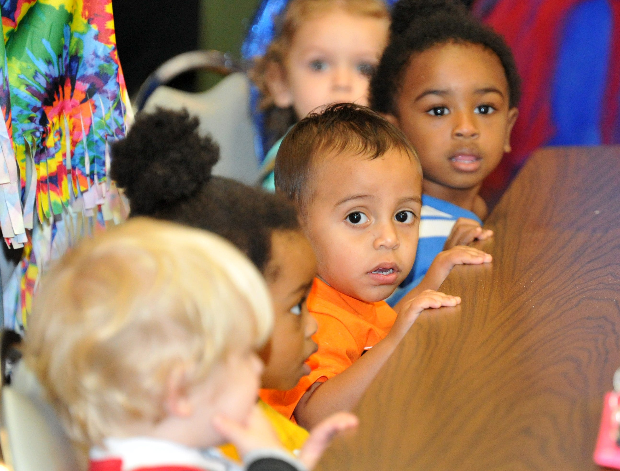 Children from Child Care Partners wait for the Halloween costume contest held at the Martin Luther King Center.