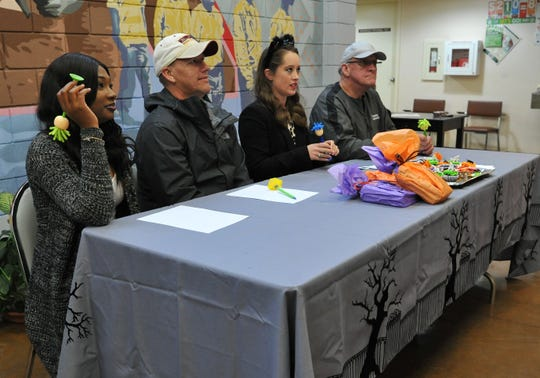 Local police, radio and TV personalities served as judges during a Halloween costume contest held at the Martin Luther King Center, Wednesday afternoon.
