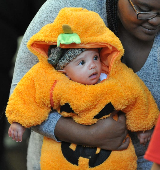 3-month-old, Justin Nally was dressed as a pumpkin, Wednesday afternoon, during the Martin Luther King Center's Halloween costume contest.