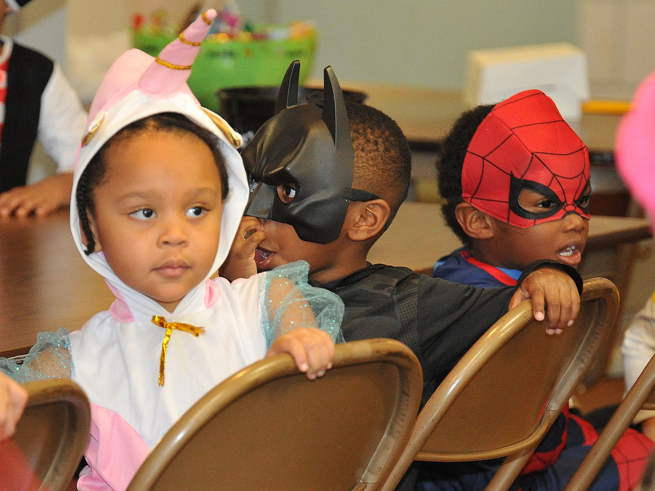 2-year-old Malaya King, left, was dressed as a pink unicorn during the Martin Luther King Center's Halloween costume contest held Wednesday afternoon.