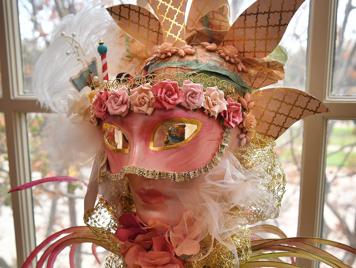 "An intricate mixed media piece titled, ""Memories of Venice"", features images visible through the eyes of the mask created by artist Kristin Edwards."