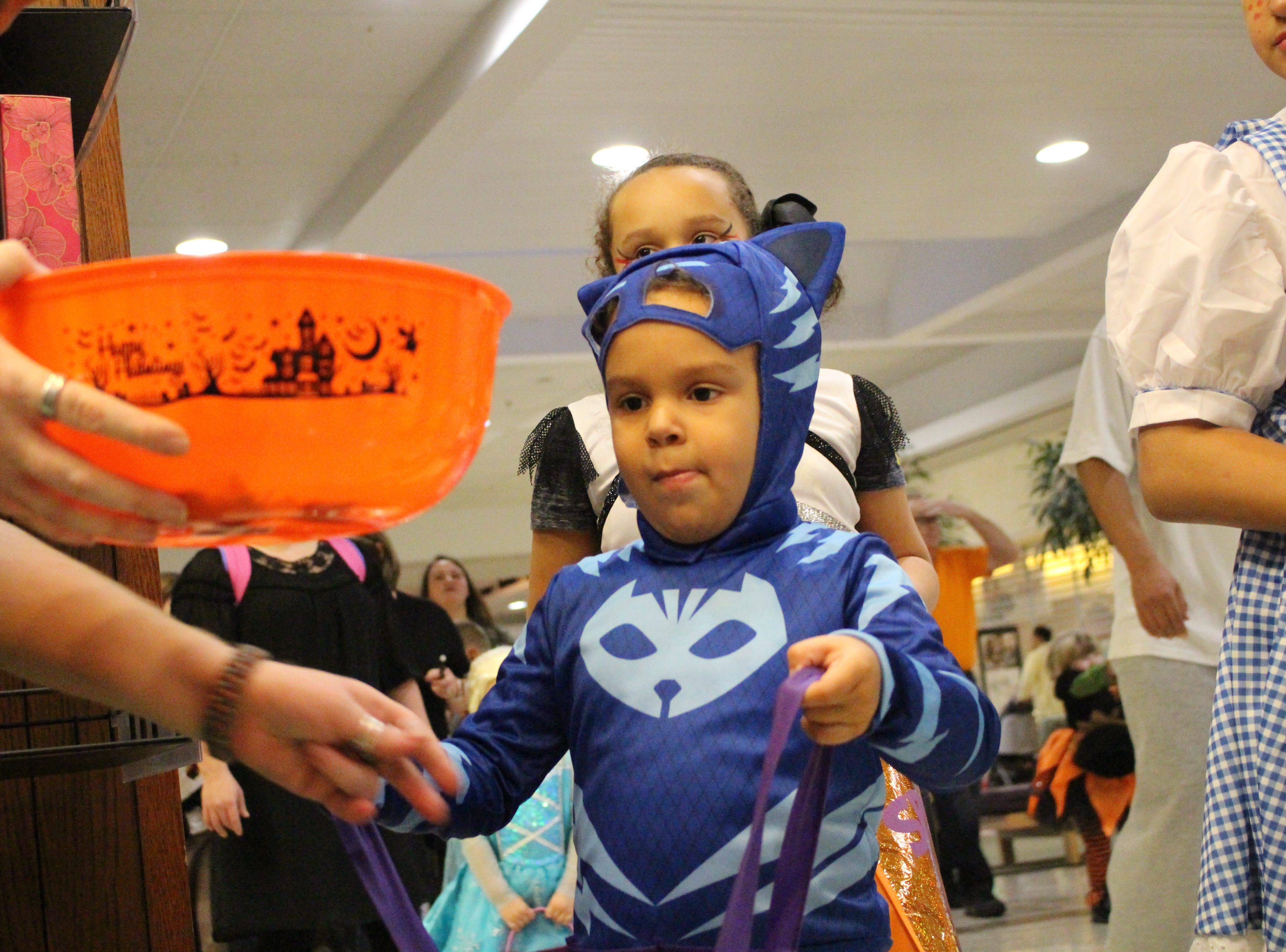 Children and families circled Colony Square Mall, grabbing candy and goodies on Halloween night.