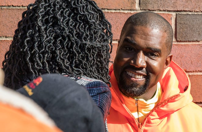 "Chicago mayoral candidate Amara Enyia, left, chats with Kanye West during a ""pull-up"" rally Tuesday, Oct. 23, 2018, in Chicago."