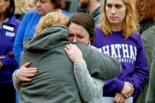 Chatham University students hug during a visit Thursday, Nov. 1, 2018, to a makeshift memorial outside the Tree of Life synagogue dedicated to the 11 people killed Oct. 27 while worshipping, in the Squirrel Hill neighborhood of Pittsburgh. (AP Photo/Gene J. Puskar) ORG XMIT: PAGP113