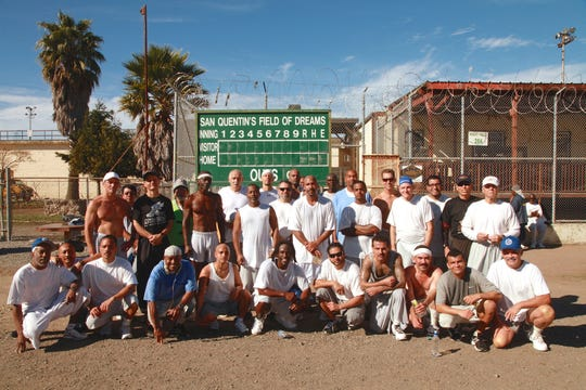 The San Quentin State Prison's 1,000-mile run club poses for a group photo. More than 30 inmates run on the team, and 20 are expected to finish a Nov. 16 behind-bars marathon.