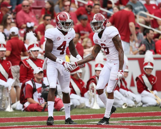 Alabama wide receiver Jerry Jeudy (4) celebrates with wide receiver DeVonta Smith after scoring a touchdown against Arkansas.