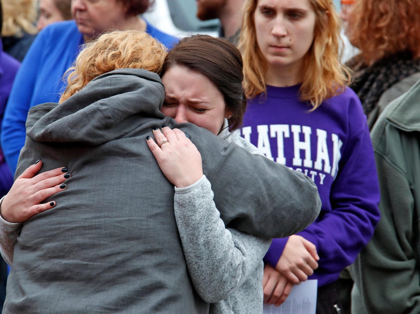 Chatham University students hug during a visit Thursday, Nov. 1, 2018, to a makeshift memorial outside the Tree of Life Synagogue to the 11 people killed Oct 27, 2018 while worshipping in the Squirrel Hill neighborhood of Pittsburgh.
