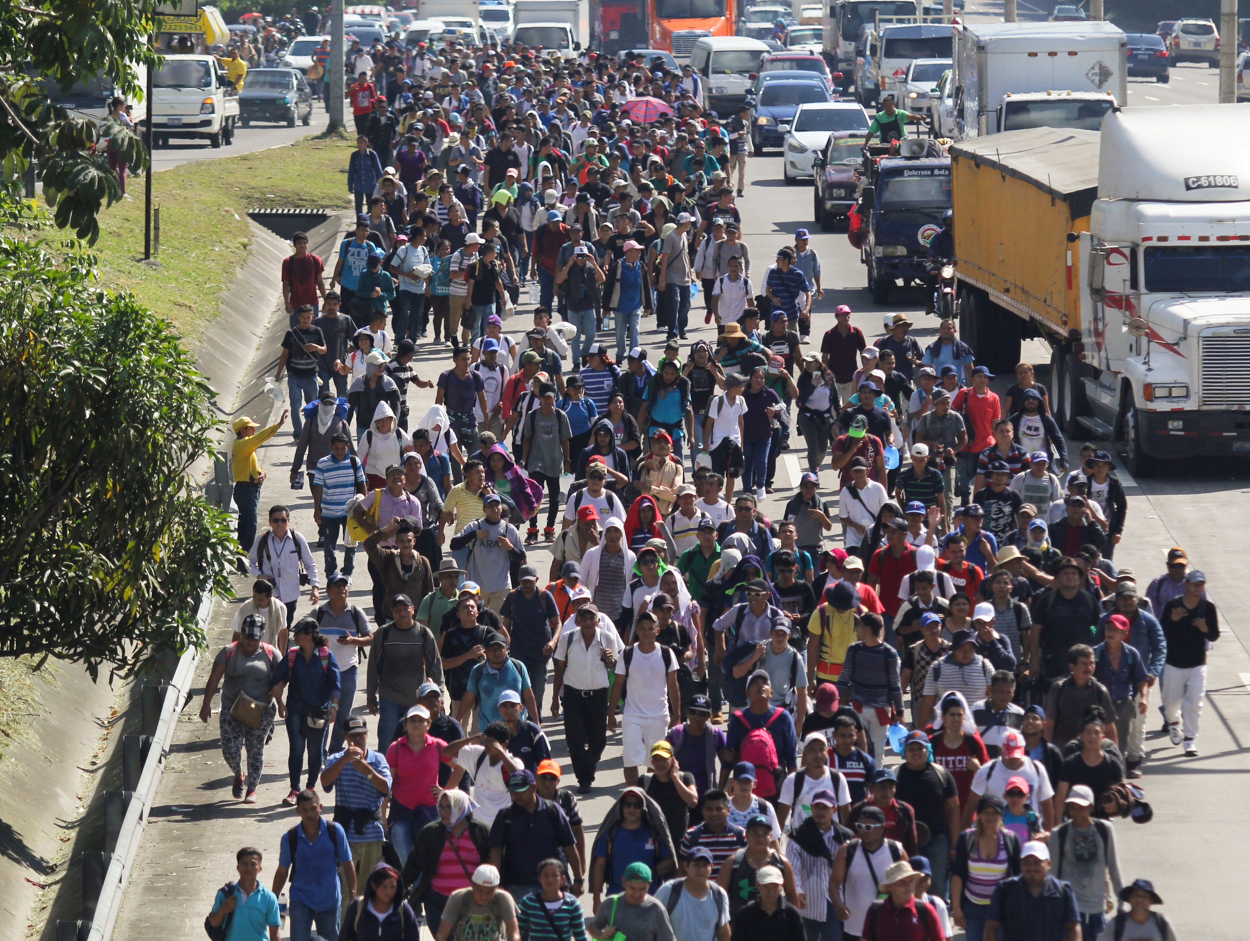 Migrants from El Salvador start on their way to the United States, in San Salvador, El Salvador, Wednesday, Oct. 31, 2018.