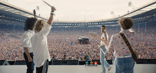 "Queen's epic Live Aid set, re-created by Gwilym Lee (as Brian May, from left), Ben Hardy (Roger Taylor), Rami Malek (Freddie Mercury) and Joe Mazzello (John Deacon), is the centerpiece of the biopic ""Bohemenian Rhapsody."""