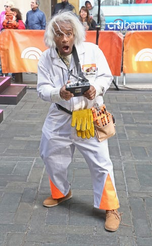 "Broadcaster Al Roker dressed up as ""Back to the Future"" character Doc Brown during the NBC ""Today"" Halloween 2018 at Rockefeller Plaza."