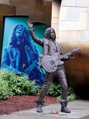 A life-size, bronze statue of late Soundgarden frontman Chris Cornell stands outside the Museum of Pop Culture a day after its unveiling, Oct. 8, 2018, in Seattle. Cornell's wife, Vicky Cornell, commissioned the piece by artist Nick Marra.