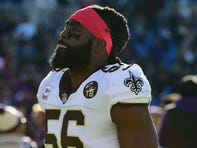 New Orleans Saints linebacker Demario Davis (56) stands on the field before the game against the Baltimore Ravens at M&T Bank Stadium.