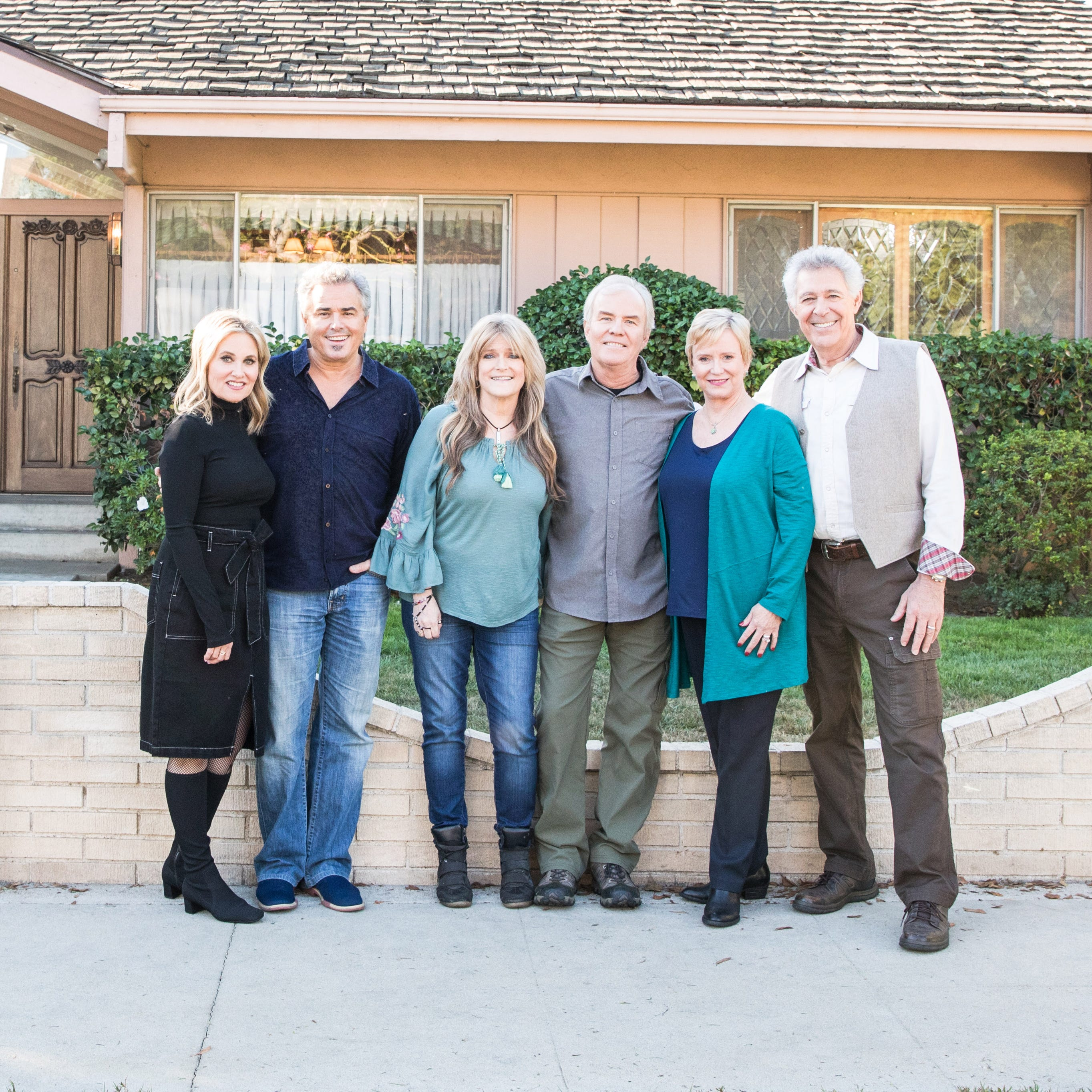 "The ""Brady Bunch"" kids today: Maureen McCormack (Marcia), Christopher Knight (Peter), Susan Olsen (Cindy), Mike Lookinland  (Bobby), Eve Plumb (Jan) and  Barry Williams (Greg Brady) pose in front of the original Brady home in Studio City, California."