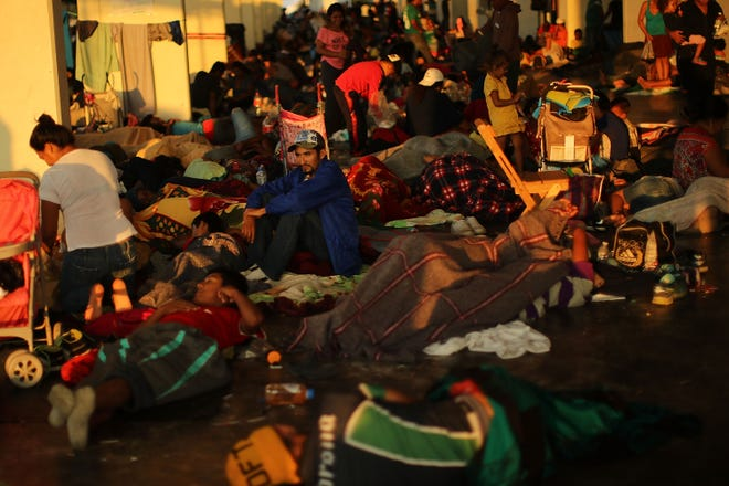 Members of the Central American caravan wake up at dawn in a camp on Oct. 31, 2018 in Juchitan de Zaragoza, Mexico.