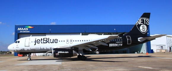JetBlue unveiled one of its Airbus A320 jets painted in the colors of the Brooklyn Nets NBA pro basketball franchise.