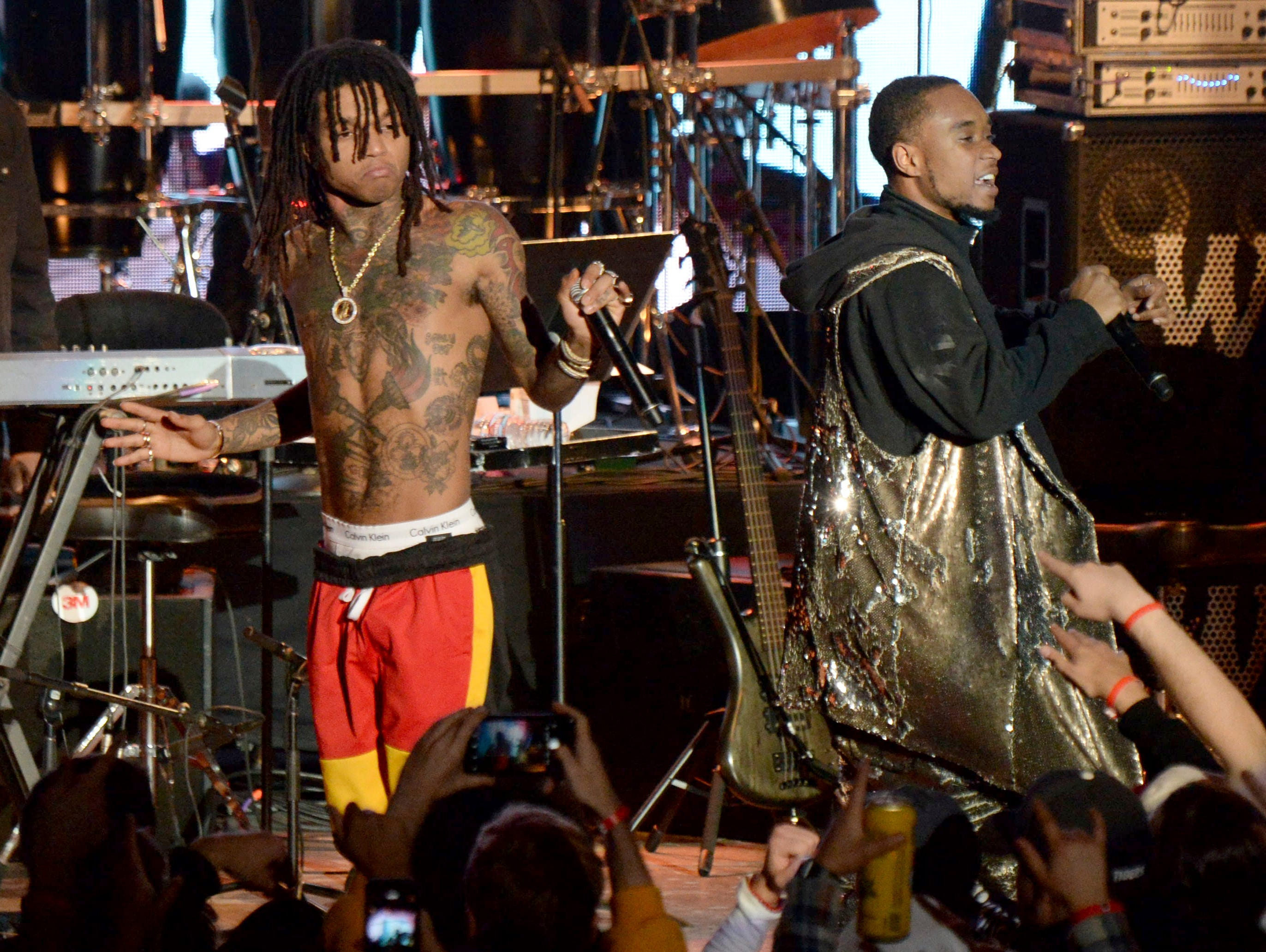 Swae Lee, left, and Slim Jxmmi, of Rae Sremmurd, perform during the tribute event Mac Miller: A Celebration of Life on Wednesday, Oct. 31, 2018, at the Greek Theatre in Los Angeles. (Photo by Amy Harris/Invision/AP) ORG XMIT: CAPM113