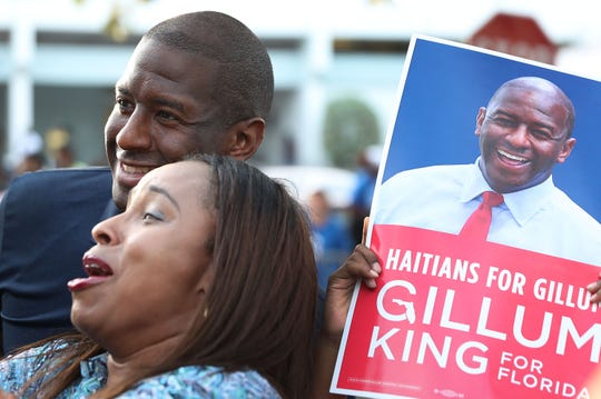 Florida Democratic gubernatorial nominee Andrew Gillum poses for a photo with a supporter as he stumps for votes Nov. 1, 2018, in Miami Gardens, Florida.